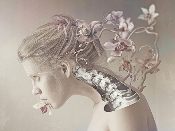surreal illustration of woman with orchids growing out of her body