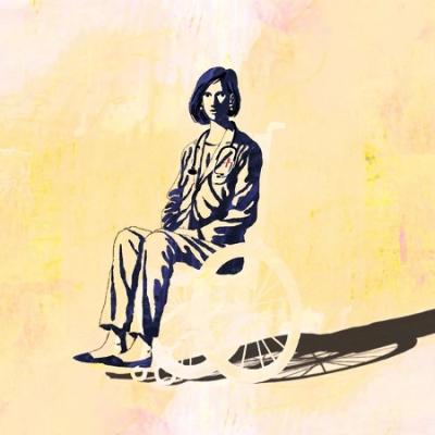 yellow and black block print of woman using wheelchair
