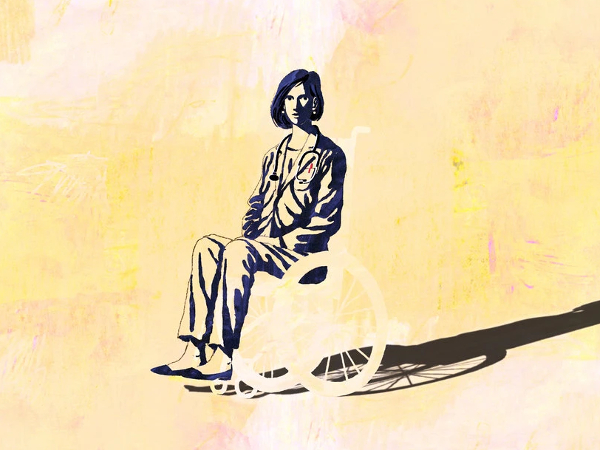 yellow and black block print of woman using wheelchair