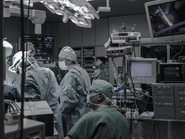 dimly lit operating room with surgeons